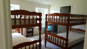 "AFTER - good stuff for the ""Big House"" We have furnishings that will actually sleep 12. this is new bunk beds I found for one room, we have 2 queens in bedrooms."